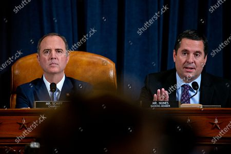 Representative Devin Nunes, a Republican from California and ranking member of the House Intelligence Committee, right, questions witnesses as chairman Representative Adam Schiff, a Democrat from California, listens during an impeachment inquiry hearing in Washington, DC, USA, 21 November 2019. The impeachment inquiry is being led by three congressional committees and was launched following a whistleblower's complaint that alleges US President Donald J. Trump requested help from the President of Ukraine to investigate a political rival, Joe Biden and his son Hunter Biden.