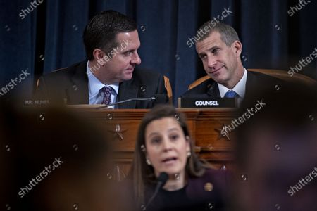 Representative Devin Nunes, a Republican from California and ranking member of the House Intelligence Committee, top left, talks to Steve Castor, general counsel for the Oversight and Government Reform Committee, as Representative Elise Stefanik, a Republican from New York, bottom, questions witnesses during an impeachment inquiry hearing in Washington, DC, USA, 21 November 2019. The impeachment inquiry is being led by three congressional committees and was launched following a whistleblower's complaint that alleges US President Donald J. Trump requested help from the President of Ukraine to investigate a political rival, Joe Biden and his son Hunter Biden.