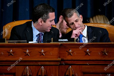 Representative Devin Nunes, a Republican from California and ranking member of the House Intelligence Committee, left, talks to Steve Castor, general counsel for the Oversight and Government Reform Committee, during an impeachment inquiry hearing in Washington, DC, USA, 21 November 2019. The impeachment inquiry is being led by three congressional committees and was launched following a whistleblower's complaint that alleges US President Donald J. Trump requested help from the President of Ukraine to investigate a political rival, Joe Biden and his son Hunter Biden.