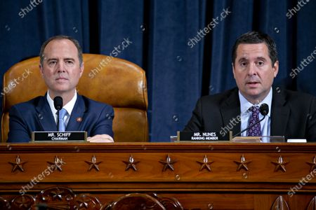 Stock Photo of Representative Devin Nunes, a Republican from California and ranking member of the House Intelligence Committee, right, makes a closing statement as chairman Representative Adam Schiff, a Democrat from California, listens during an impeachment inquiry hearing in Washington, DC, USA, 21 November 2019. The impeachment inquiry is being led by three congressional committees and was launched following a whistleblower's complaint that alleges US President Donald J. Trump requested help from the President of Ukraine to investigate a political rival, Joe Biden and his son Hunter Biden.