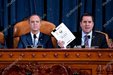 Representative Devin Nunes, a Republican from California and ranking member of the House Intelligence Committee, right, speaks as Representative Adam Schiff, a Democrat from California and chairman of the House Intelligence Committee, listens during the House Intelligence Committee impeachment inquiry hearing in Washington, D.C., USA, 21 November 2019, on President Donald Trump's efforts to tie U.S. aid for Ukraine to investigations of his political opponents.
