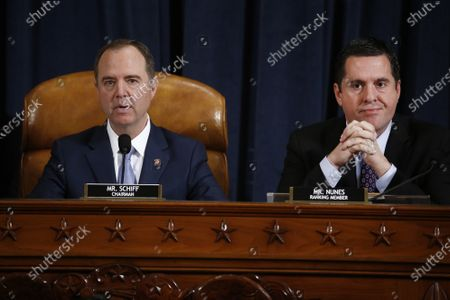 Representative Adam Schiff, a Democrat from California and chairman of the House Intelligence Committee, left, speaks as Representative Devin Nunes, a Republican from California and ranking member of the House Intelligence Committee, listens during the House Intelligence Committee impeachment inquiry hearing in Washington, D.C., USA, 21 November 2019, on President Donald Trump's efforts to tie U.S. aid for Ukraine to investigations of his political opponents.