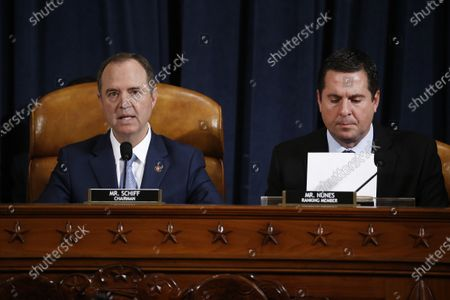 Representative Adam Schiff, a Democrat from California and chairman of the House Intelligence Committee, left, speaks as Representative Devin Nunes, a Republican from California and ranking member of the House Intelligence Committee, reviews paperwork during the House Intelligence Committee impeachment inquiry hearing in Washington, D.C., USA, 21 November 2019, on President Donald Trump's efforts to tie U.S. aid for Ukraine to investigations of his political opponents.