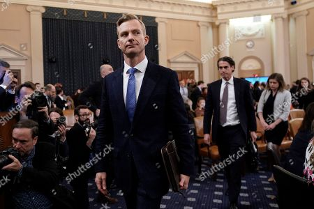 David Holmes, a U.S. diplomat in Ukraine, departs after testifying before the House Intelligence Committee on Capitol Hill in Washington, during a public impeachment hearing of President Donald Trump's efforts to tie U.S. aid for Ukraine to investigations of his political opponents