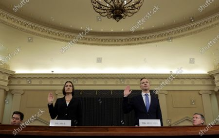 Fiona Hill (L), the National Security Councils former senior director for Europe and Russia, and David Holmes (R), an official from the American Embassy in Ukraine, are sworn in to testify before the House Intelligence Committee in the Longworth House Office Building on Capitol Hill in Washington, DC, USA, 21 November 2019. The committee heard testimony during the fifth day of open hearings in the impeachment inquiry against U.S. President Donald Trump, whom House Democrats say held back U.S. military aid for Ukraine while demanding it investigate his political rivals and the unfounded conspiracy theory that Ukrainians, not Russians, were behind the 2016 computer hacking of the Democratic National Committee.