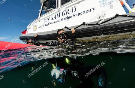 "Stock Picture of Kimberly Roberson, research coordinator for Gray's Reef National Marine Sanctuary, foreground, and Justin Miyano, vessel operations coordinator, surface after scuba diving in the sanctuary Monday, Oct. 28, 2019, off the coast of Savannah, Ga. The site is named after Milton ""Sam"" Gray, a biologist who studied it in the 1960s and identified it as an ecosystem worth saving _ a reef not far from the U.S. coast that teemed with life, especially an ""abundance of diversity of invertebrates,"" says Roberson"