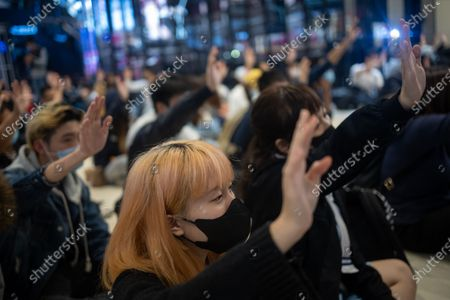Stock Image of Pro-democracy protesters attend a sit in at a mall in Yuen Long, Hong Kong, China, 21 November 2019. The protesters were marking the fourth month since an assault carried out by a group of white-clad men targeted protesters and passengers in the Yuen Long MTR station on 21 July 2019. Hong Kong is in its sixth month of mass protests, which were originally triggered by a now withdrawn extradition bill, and have since turned into a wider pro-democracy movement.