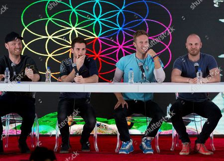 Jonny Buckland, Guy Berryman, Chris Martin, Will Champion. Members of British band Coldplay, from left, Jonny Buckland, Guy Berryman, Chris Martin, and Will Champion, participate in a press conference at Foro Sol in Mexico City. The British band Coldplay has decided not to launch a global tour because of environmental concerns. Frontman Chris Martin told the BBC Thursday, Nov. 21, 2019 that the band is not going on tour to promote its latest album because it wants to take time to determine how a tour can be beneficial to the environment