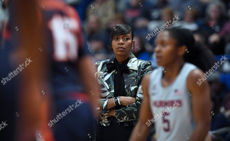 Stock Photo of Virginia head coach Tina Thompson during the first half of an NCAA college basketball game, in Hartford, Conn