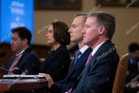 Former National Security Council Russia expert Fiona Hill and Counselor for Political Affairs at the U.S. Embassy in Ukraine David Holmes listen to opening remarks prior to their testimony before the U.S. House Permanent Select Committee on Intelligence on Capitol Hill