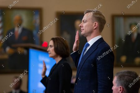 Former National Security Council Russia expert Fiona Hill and Counselor for Political Affairs at the U.S. Embassy in Ukraine David Holmes are sworn in for testimony before the U.S. House Permanent Select Committee on Intelligence on Capitol Hill
