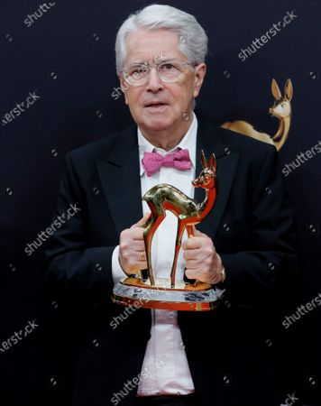 Stock Photo of German TV host Frank Elstner poses with his 'life's work' award at the 71st annual Bambi awards ceremony in Baden Baden, Germany, 21 November 2019. The awards recognize excellence in international media and television.