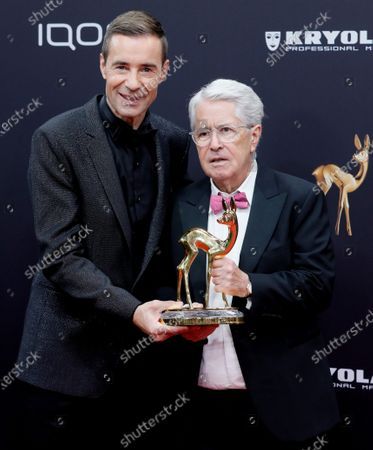 Stock Image of German TV host Frank Elstner (R) receives the 'life's work' award from German TV host and laudator Kai Pflaume at the 71st annual Bambi awards ceremony in Baden Baden, Germany, 21 November 2019. The awards recognize excellence in international media and television.