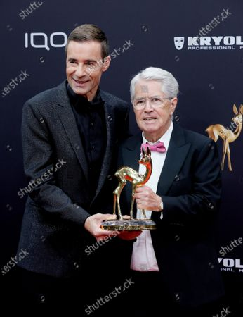 Stock Picture of German TV host Frank Elstner (R) receives the 'life's work' award from German TV host and laudator Kai Pflaume at the 71st annual Bambi awards ceremony in Baden Baden, Germany, 21 November 2019. The awards recognize excellence in international media and television.