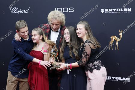 Stock Picture of Thomas Gottschalk poses with German students and members of the Federation of the German Catholic Youth with the 'Our future' award at the 71st annual Bambi awards ceremony in Baden Baden, Germany, 21 November 2019. The awards recognize excellence in international media and television.