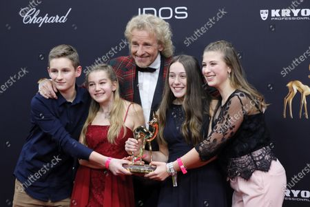 Stock Image of Thomas Gottschalk poses with German students and members of the Federation of the German Catholic Youth with the 'Our future' award at the 71st annual Bambi awards ceremony in Baden Baden, Germany, 21 November 2019. The awards recognize excellence in international media and television.