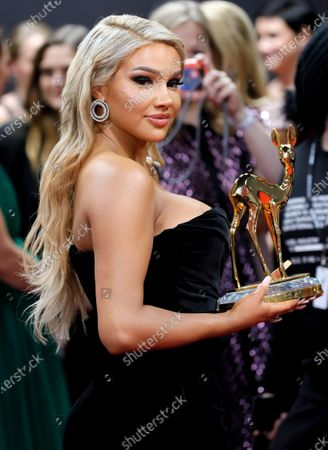Shirin David poses with her 'Shootingstar' award at the 71st annual Bambi awards ceremony in Baden Baden, Germany, 21 November 2019. The awards recognize excellence in international media and television.