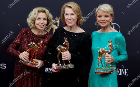 Michaela May, Gaby Dohm and Uschi Glas pose with their 'honorary prize of the jury' award at the 71st annual Bambi awards ceremony in Baden Baden, Germany, 21 November 2019. The awards recognize excellence in international media and television.