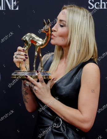 Sarah Connor poses with her 'Music National' award at the 71st annual Bambi awards ceremony in Baden Baden, Germany, 21 November 2019. The awards recognize excellence in international media and television.