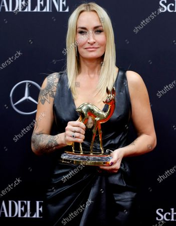 Sarah Connor poses with her 'Music National' award at the 71th annual Bambi awards ceremony in Baden Baden, Germany, 21 November 2019. The awards recognize excellence in international media and television.