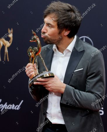 Max Giesinger poses with his 'Audiences' award at the 71st annual Bambi awards ceremony in Baden Baden, Germany, 21 November 2019. The awards recognize excellence in international media and television.