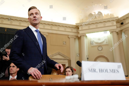David Holmes, a U.S. diplomat in Ukraine, returns from a break to testify before the House Intelligence Committee on Capitol Hill in Washington, during a public impeachment hearing of President Donald Trump's efforts to tie U.S. aid for Ukraine to investigations of his political opponents