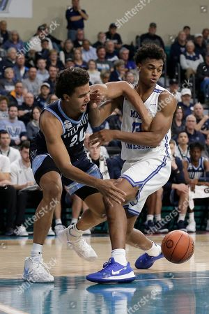 Villanova forward Jeremiah Robinson-Earl (24) and Middle Tennessee State guard Jayce Johnson (13) srtruggle for the ball during the second half of an NCAA college basketball game at the Myrtle Beach Invitational in Conway, S.C