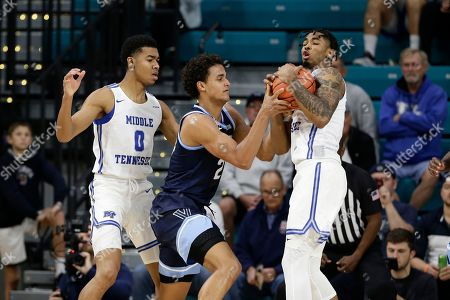 Middle Tennessee State guard Anthony Crump (0) and forward Tyler Millin pressure Villanova forward Jeremiah Robinson-Earl, center, during the first half of an NCAA college basketball game at the Myrtle Beach Invitational in Conway, S.C