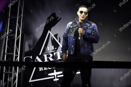 Puerto Rican reggaeton singer Daddy Yankee attends the press presentation of a museum dedicated to his life and music in the Plaza Las Americas shopping center in San Juan, Puerto Rico, 21 November 2019. The Daddy Yankee El Jefe Museum that opens to the public on 22 November 2019 will be the first museum in the world to explore the history of reggaeton through the eyes of the self-styled 'boss' of reggaeton, as well as feature memorabilia and awards of the artist.