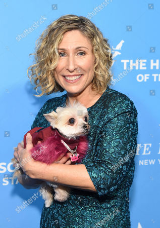 President and CEO, HSUS Kitty Block walks the red carpet with the dog Ella Bean at the Humane Society of the United States To the Rescue! New York Gala on in New York. In its tenth year, the event honored consumer goods company Unilever; MUTTS cartoonist and children's book author Patrick McDonnell; and the Alex & Elisabeth Lewyt Charitable Trust. The evening was hosted by Jerry O'Connell and Rebecca Romijn and featured a performance by singer-songwriter Gavin DeGraw