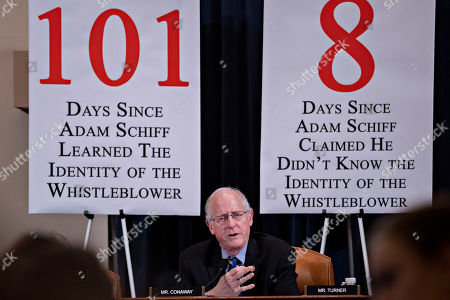 Rep. Mike Conaway, R-Texas, questions former White House national security aide Fiona Hill, and David Holmes, a U.S. diplomat in Ukraine, as they testify before the House Intelligence Committee on Capitol Hill in Washington, during a public impeachment hearing of President Donald Trump's efforts to tie U.S. aid for Ukraine to investigations of his political opponents