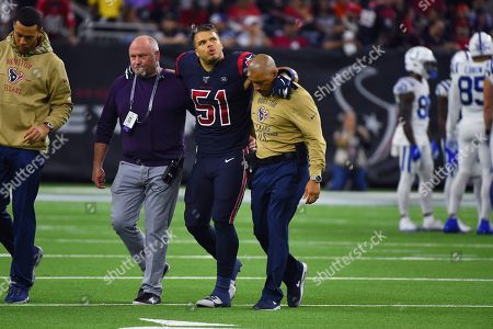 Houston Texans linebacker Dylan Cole (51) is helped off the field during the first half of an NFL football game against the Indianapolis Colts, in Houston