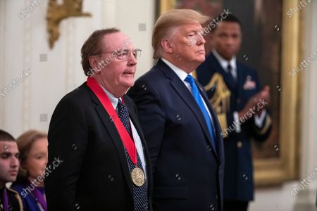 Author James Patterson (L) poses with US President Donald Trump (R) after receiving the National Humanities Medal in the East Room of the White House in Washington, DC, USA, 21 November 2019.