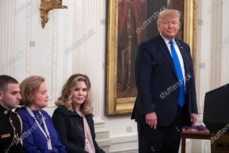 Singer Alison Krauss (C-R) waits for US President Donald Trump (R) to present the National Medal of Arts and the National Humanities Medal to her and seven other recipients in the East Room of the White House in Washington, DC, USA, 21 November 2019.