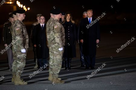 Donald Trump, Melania Trump. President Donald Trump and first lady Melania Trump participate in a casualty return ceremony for Chief Warrant Officer 2 David C. Knadle, of Tarrant, Texas, and Chief Warrant Officer 2 Kirk T. Fuchigami Jr., of Keaau, Hawaii, who according to the Department of Defense died in Afghanistan, in Dover Air Force Base, Del