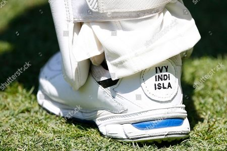 Australia's David Warner has the names of his daughters Ivy Mae, 5, Indy Rae, 3, and Isla Rose, 5 months, embroidered on his shoes as his inspiration during their cricket test match against Pakistan in Brisbane, Australia