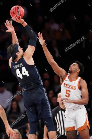 Royce Hamm Jr., Omer Yurtseven. Texas forward Royce Hamm Jr. (5) defends Georgetown center Omer Yurtseven (44) during the first half of the first round of the 2K Empire Classic NCAA college basketball tournament, in New York