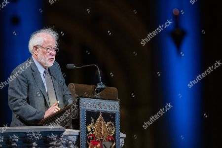 Poet Michael Ondaatje speaks during the Celebration of the Life of Toni Morrison, at the Cathedral of St. John the Divine in New York. Morrison, a Nobel laureate, died in August at 88