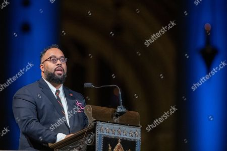 Poet Kevin Young speaks during the Celebration of the Life of Toni Morrison, at the Cathedral of St. John the Divine in New York. Morrison, a Nobel laureate, died in August at 88