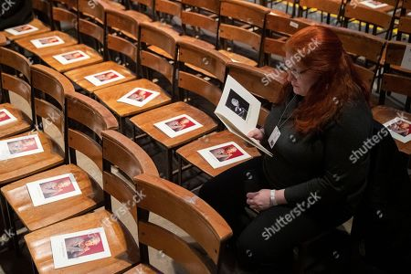 A woman looks through the program before the start of the Celebration of the Life of Toni Morrison, at the Cathedral of St. John the Divine in New York