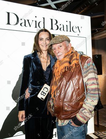 David Bailey photographed with wife Catherine Bailey at an event to promote his work on a giant electric billboard on Oxford Street as part of an art project