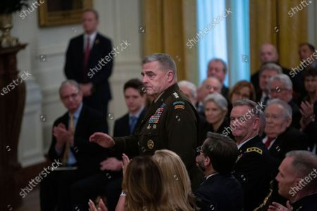 United States Army General Mark A. Milley is introduced by United States President Donald Trump during an East Room ceremony where Trump awarded Alison Krauss, Sharon Percy Rockefeller, the Musicians of the United States Military, Jon Voight, the Claremont Institute, Theresa Lozano Long, Patrick J. O'Connell, and James Patterson the National Medal of Arts and the National Humanities Medal