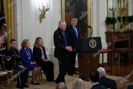 Stock Image of Jon Voight dances as United States President Donald Trump introduces him during an East Room ceremony where he awarded Voight, as well as Alison Krauss, Sharon Percy Rockefeller, the Musicians of the United States Military, the Claremont Institute, Theresa Lozano Long, Patrick J. O'Connell, and James Patterson the National Medal of Arts and the National Humanities Medal