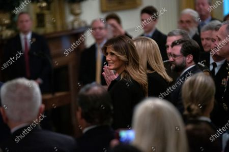 First lady Melania Trump arrives to an East Room ceremony where United States President Donald Trump awarded Alison Krauss, Sharon Percy Rockefeller, the Musicians of the United States Military, Jon Voight, the Claremont Institute, Theresa Lozano Long, Patrick J. O'Connell, and James Patterson the National Medal of Arts and the National Humanities Medal