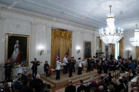 Musicians play prior to an East Room ceremony where United States President Donald Trump awarded Alison Krauss, Sharon Percy Rockefeller, the Musicians of the United States Military, Jon Voight, the Claremont Institute, Theresa Lozano Long, Patrick J. O'Connell, and James Patterson the National Medal of Arts and the National Humanities Medal