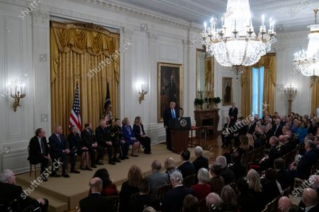 United States President Donald Trump speaks during an East Room ceremony where he awarded Alison Krauss, Sharon Percy Rockefeller, the Musicians of the United States Military, Jon Voight, the Claremont Institute, Theresa Lozano Long, Patrick J. O'Connell, and James Patterson the National Medal of Arts and the National Humanities Medal