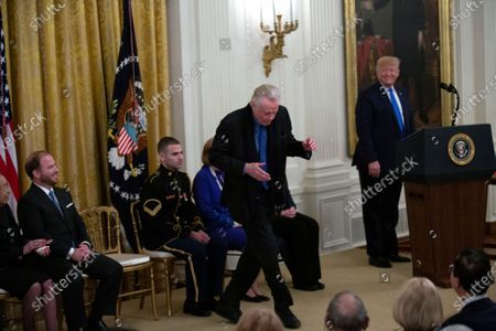 Jon Voight dances as United States President Donald Trump introduces him during an East Room ceremony where he awarded Voight, as well as Alison Krauss, Sharon Percy Rockefeller, the Musicians of the United States Military, the Claremont Institute, Theresa Lozano Long, Patrick J. O'Connell, and James Patterson the National Medal of Arts and the National Humanities Medal
