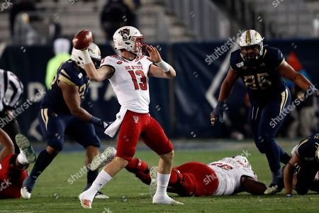 North Carolina State quarterback Devin Leary (13) throws from the pocket against Georgia Tech during the first half of an NCAA college football game, in Atlanta