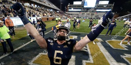 Stock Image of Georgia Tech linebacker David Curry celebrates after the team's 28-26 win over North Carolina State in an NCAA college football game, in Atlanta