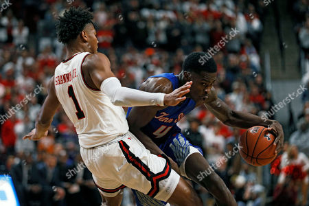 Tennessee State's Wesley Harris (4) knocks down Texas Tech's Terrence Shannon Jr. (1) while driving the ball to the basket during the first half of an NCAA college basketball game, in Lubbock, Texas